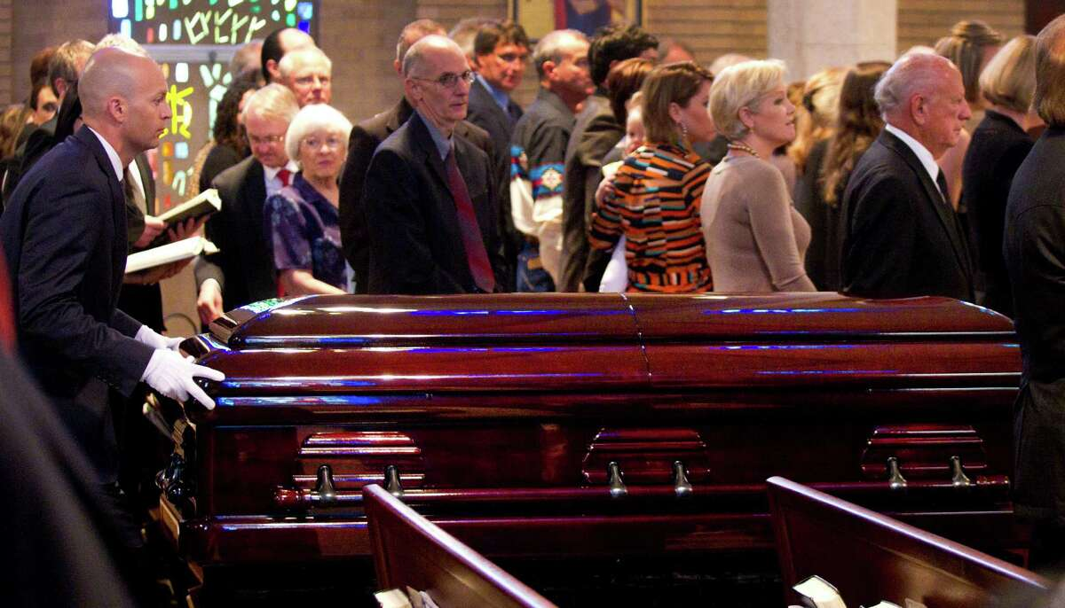The casket of Jack Pardee, the former University of Houston and Houston Oilers head coach, is brought into the sanctuary for the coach's funeral at St. Michael Catholic Church on Monday, April 8, 2013, in Houston.