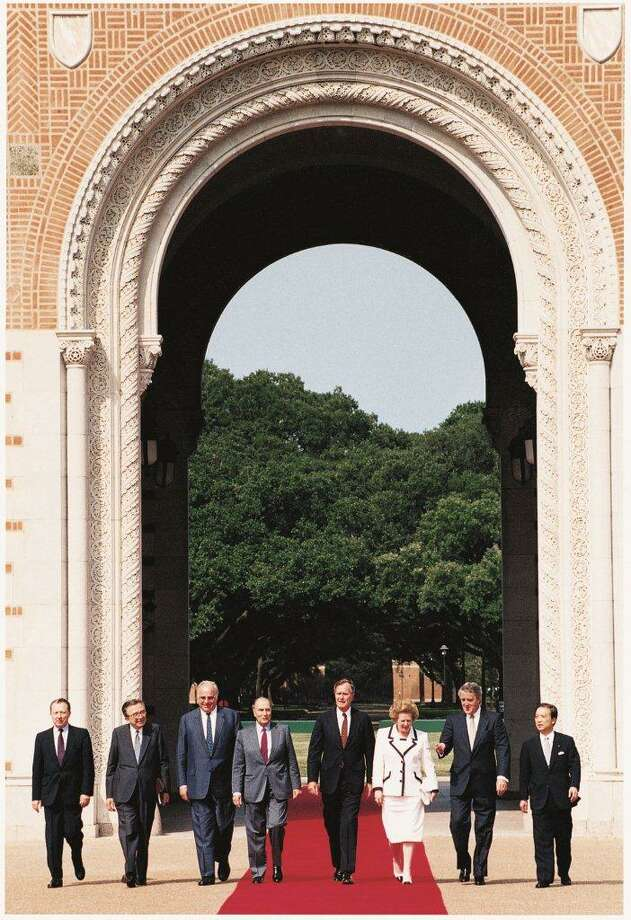 G-7 members walk through the Sallyport of Lovett Hall at Rice University in July 1990. Of note, Soviet Union President Mikhail Gorbachev, third from left, U.S. President George H.W. Bush, center, and British Prime Minister Margaret Thatcher.See more photos: Thatcher's life through the years. Photo: Rice University