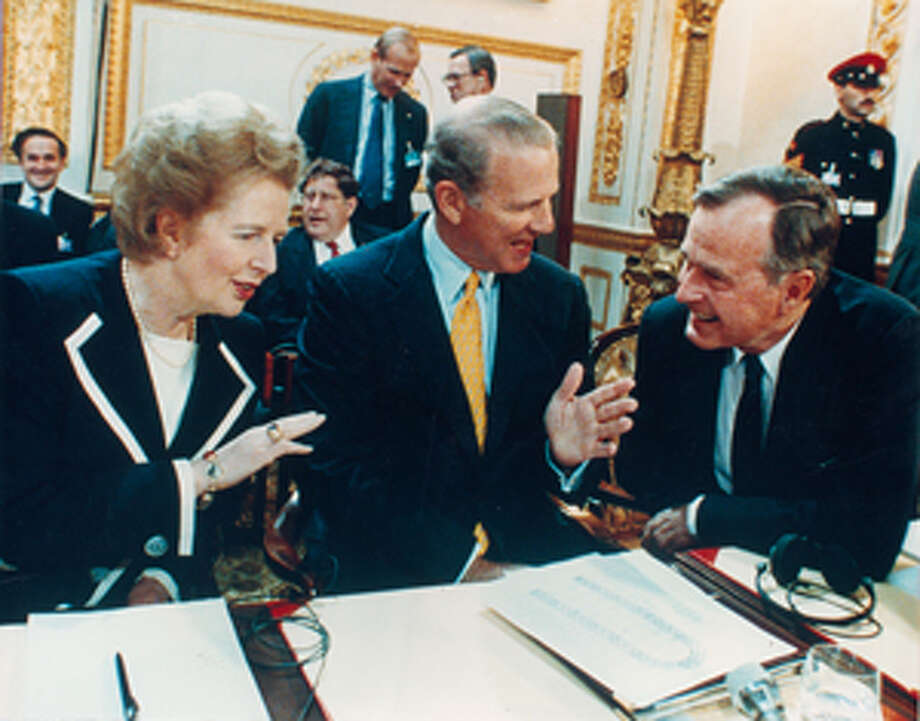 British Prime Minister Margaret Thatcher, then-Secretary of State James A. Baker, III, and President George H.W. Bush are shown in 1991. (File photo)