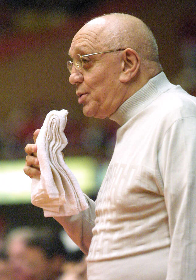 Fresno State basketball coach Jerry Tarkanian chews on a towel during his team's loss to Temple in the last game of the season, Wednesday, March 13, 2002, in Fresno, Calif. Tarkanian retired from coaching college basketball Friday, tossing in his chewed-up towel after a career that mixed success with scandal over four decades. The 71-year-old coach will become a consultant for Fresno State, his alma mater, where he coached the last seven years. (AP Photo/Gary Kazanjian) Photo: GARY KAZANJIAN, EN / AP