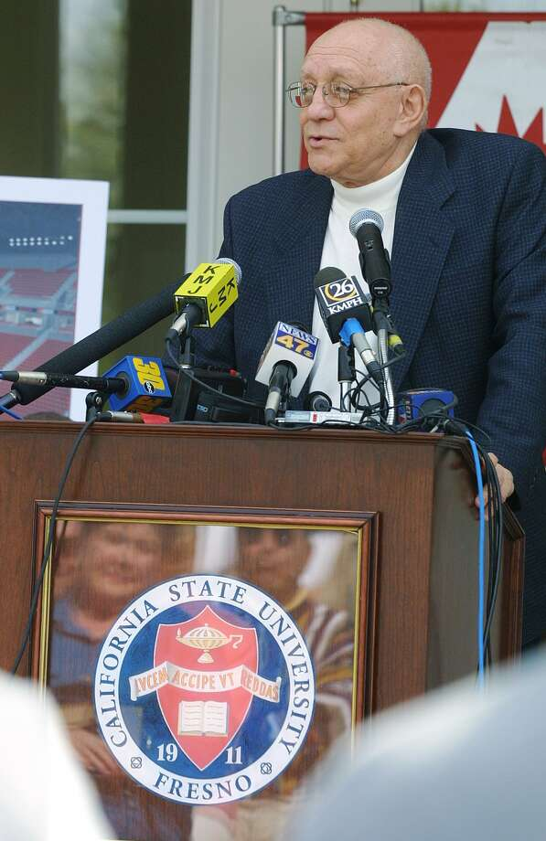 Fresno State basketball coach Jerry Tarkanian announces his retirement as his wife, Lois, looking on, is reflected in the podium Friday, March 15, 2002, in Fresno, Calif. The 71-year-old coach will become a $120,000-a-year consultant for Fresno State, his alma mater. Tarkanian finished with a 778-202 career record. He had 29 20-win seasons, and only Dean Smith had more, with 30. (AP Photo/Gary Kazanjian) Photo: GARY KAZANJIAN, EN / AP