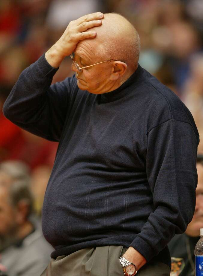 Fresno State coach Jerry Tarkanian holds his head as he watches his team fall behind to Nevada on Feb. 7, 2002, in Fresno, Calif. Nevada won 66-57. Tarkanian is retiring from college basketball, ending a coaching career that spanned four decades. (AP Photo/Fresno Bee, Kurt Hegre) Photo: KURT HEGRE, EN / FRESNO BEE