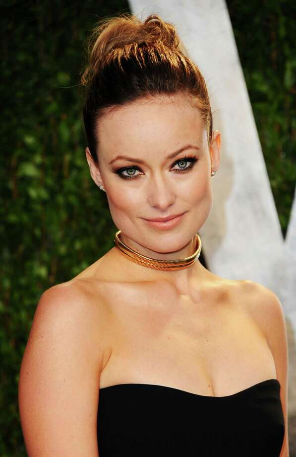 Actress Olivia Wilde was a vegan, but reportedly sought comfort in cheese after her divorce in 2011. She now sticks to a vegetarian diet. Photo: Alberto E. Rodriguez, Getty Images / 2012 Getty Images