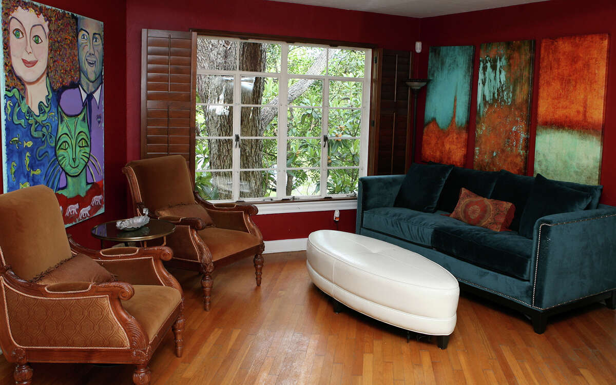 A Monte Vista house appealed to Meredith Christiansen with its funky corners, murals, light and history. Christiansen's sister painted the art on the left, depicting Christinasen and their father.
