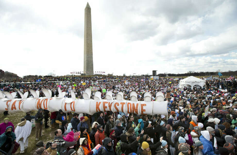 Thousands of protestors gather at the National Mall in Washington calling on President Barack Obama to reject the Keystone XL oil pipeline from Canada, as well as act to limit carbon pollution from power plants. Photo: Manuel Balce Ceneta, AP
