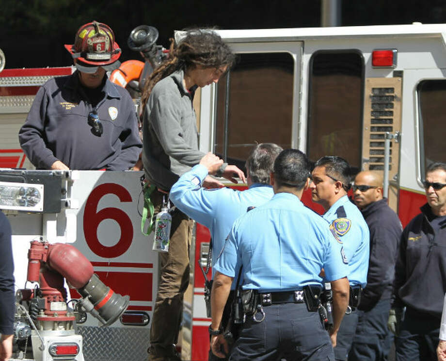 Perry Graham is arrested for trespassing after climbing a flag pole at LyondellBasell tower to protest a pipeline through Tar Springs. Photo: Nick De La Torre, Houston Chronicle