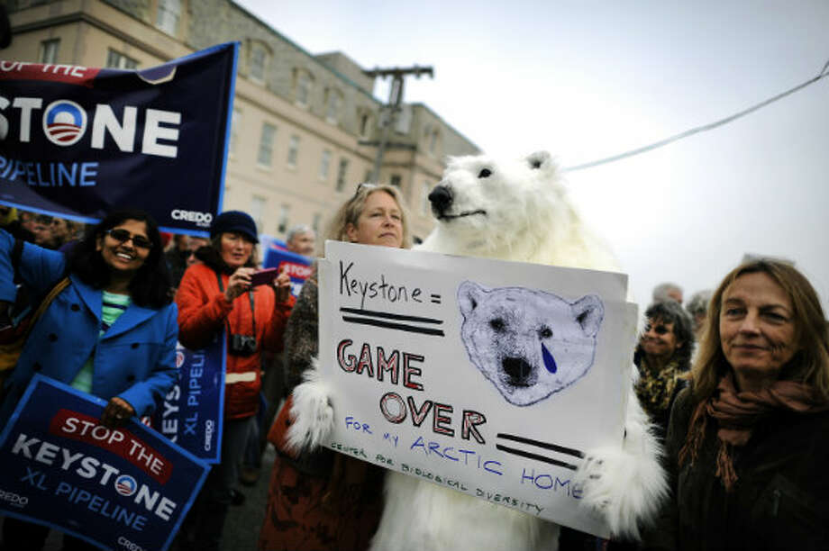 Protestors gathered in San Francisco on Wednesday April 3rd, 2013 to voice their opposition to the Keystone XL Pipeline during a visit by President Obama. Photo: Michael Short, San Francisco Chronicle