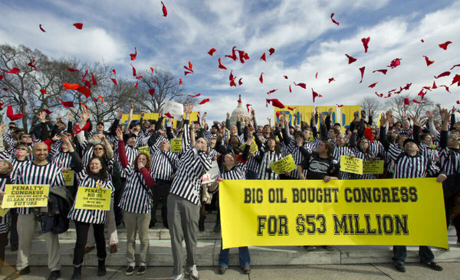 Protestors against the Keystone XL pipeline dressed as referees throw red penalty flags during a rally on Capitol Hill in Washington. President Barack Obama faces mounting pressure on a decision he put off during his re-election campaign: whether to approve the $7 billion proposed Keystone XL oil pipeline between the U.S. and Canada. Photo: Manuel Balce Ceneta, AP