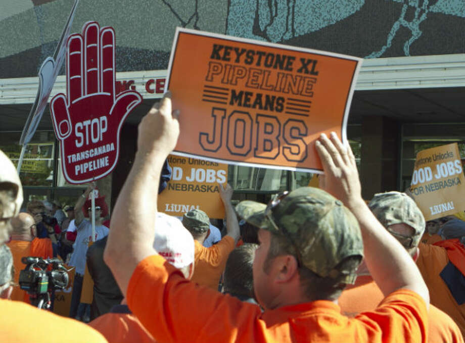 On Sept. 11, 2011, demonstrators for and against the Keystone XL pipeline gathered near the state Capitol in Lincoln, Neb., as public hearings took place about the proposed Keystone XL Pipeline, which would carry tar sands oil from Canada to Texas through the sandhills of Nebraska. Supporters of the pipeline, which include labor unions and business groups, spoke of jobs and development and energy security. Photo: Nati Harnik, AP