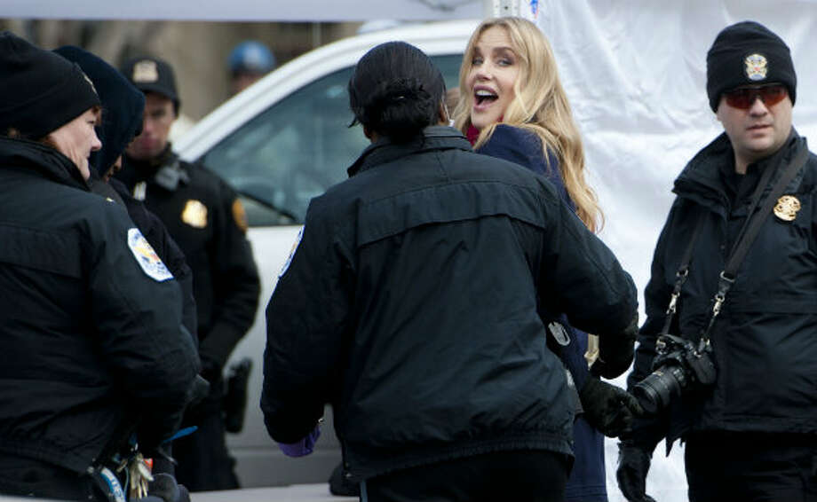 Actress Daryl Hannah is arrested outside the White House in Washington, Wednesday, Feb. 13, 2013, as prominent environmental leaders tied themselves to the White House gate to protest the Keystone XL oil pipeline. Photo: Ann Heisenfelt, AP