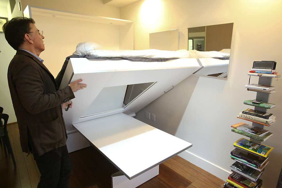 Developer Patrick Kennedy lowers the murphy bed in a micro apartment at 38 Harriet St.