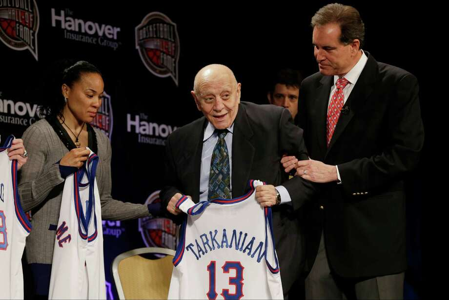 Former UNLV coach Jerry Tarkanian, center, is helped on stage by CBS announcer Jim Nantz, right, during the Naismith Memorial Basketball Hall of Fame class announcement, Monday, April 8, 2013, in Atlanta, Georgia. (AP Photo/Charlie Neibergall) Photo: Charlie Neibergall, Associated Press / AP