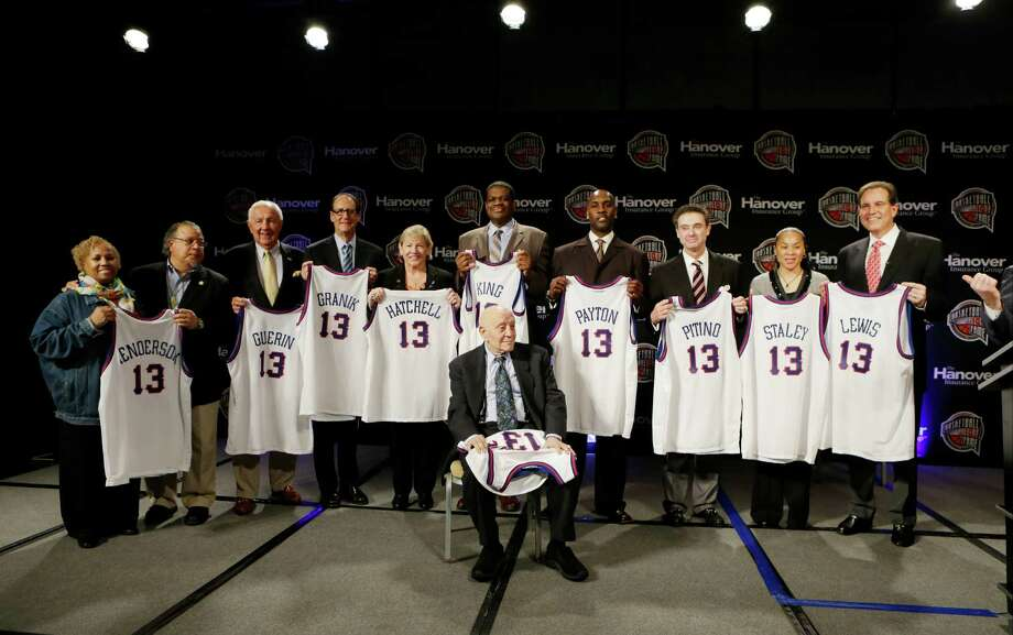 Members of the 2013 Naismith Memorial Basketball Hall of Fame class line up for a photo after inductee announcements, Monday, April 8, 2013, in Atlanta, Georgia. Shown sitting behind Jerry Tarkanian from left are Edwin and Nikki Henderson representing  Dr. E.B. Henderson, Richard Guerin, Russ Granik, Sylvia Hatchell, Bernard King, Gary Payton, Rick Pitino, Dawn Staley, and CBS announcer Jim Nantz representing Guy Lewis. (AP Photo/Charlie Neibergall) Photo: Charlie Neibergall, Associated Press / AP