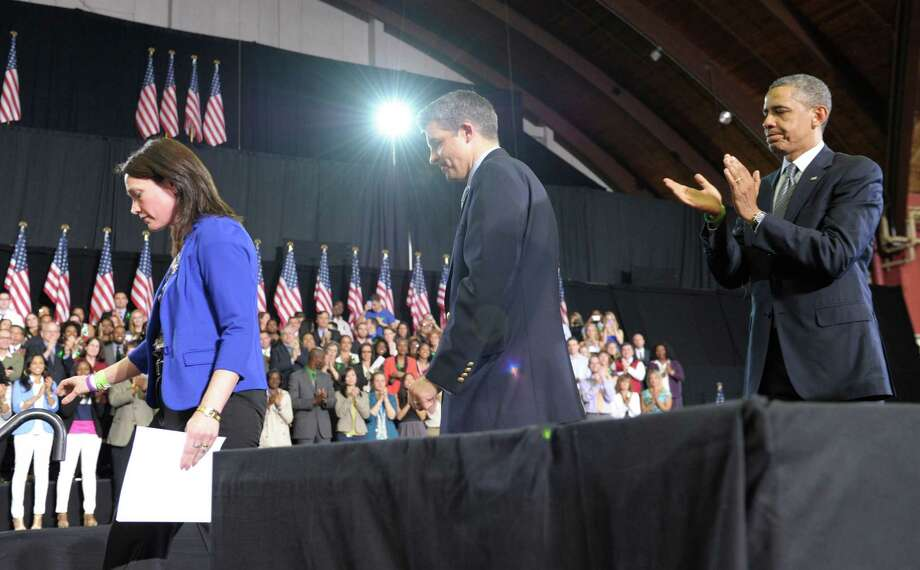 President Barack Obama applauds as Nicole Hockley's and her husband Ian walks off of the stage after she introduced Obama at the University of Hartford in Hartford, Conn., Monday, April 8, 2013. The Hockley's lost their son Dylan in the school shooting at Sandy Hook Elementary School in Newtown, Conn.  Obama said that lawmakers have an obligation to the children killed and other victims of gun violence to act on his proposals.  (AP Photo/Susan Walsh) Photo: AP