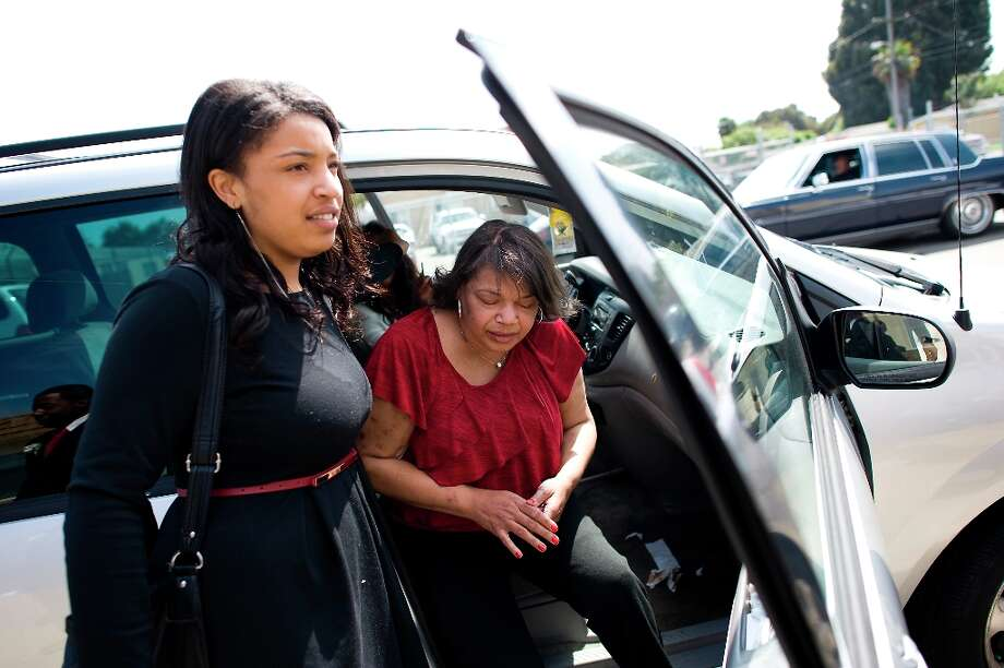 Imani Evans helps her mother, Quanikki Van Hook into the van after they attended the service to laying to rest Imani\'s great grandmother Ernestine Shepherd in Richmond, CA Saturday April 6th, 2013. Photo: Michael Short, Special To The Chronicle / ONLINE_YES