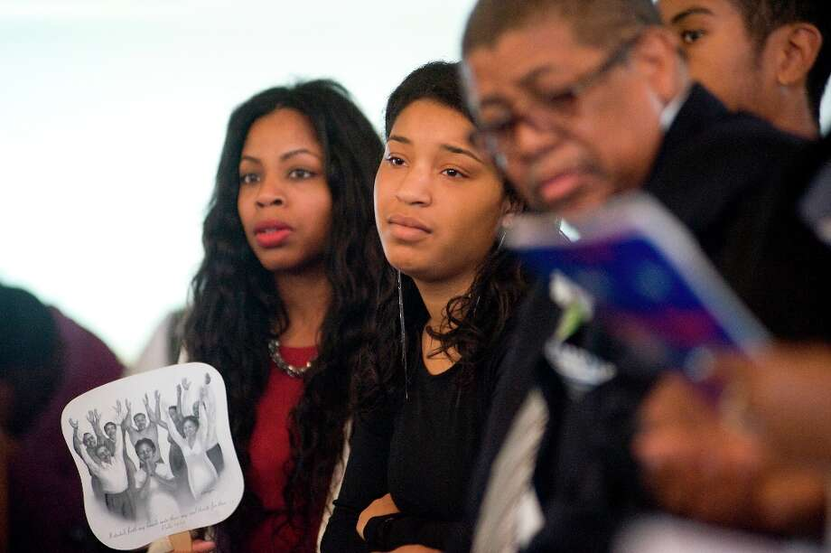 Imani Evans(2nd from left) watches as her mother reads a poem during the funeral service for Imani\'s great grandmother Ernestine Shepherd in Richmond, CA Saturday April 6th, 2013. Photo: Michael Short, Special To The Chronicle / ONLINE_YES