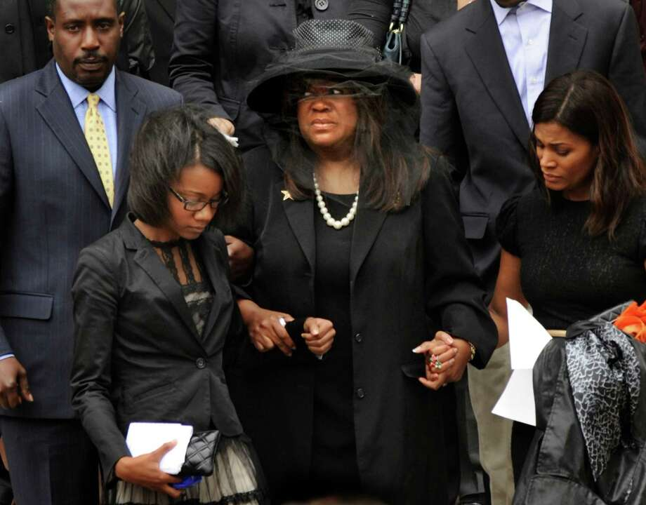 Chaz Ebert, center, wife of film critic Roger Ebert leaves Holy Name Cathedral after his funeral in Chicago, April 8, 2013. The Pulitzer Prize-winning movie reviewer died Thursday, April 4 at age 70 after a long battle with cancer. (AP Photo/Paul Beaty) Photo: Paul Beaty