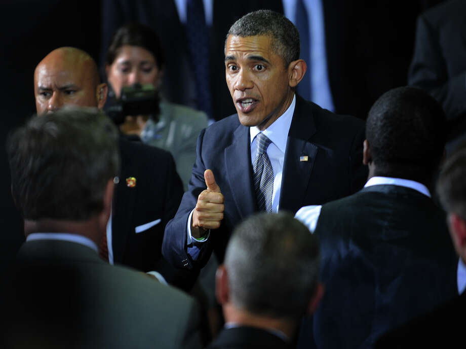President Barack Obama delivers a thumbs up while greeting state law makers and Sandy Hook family members following a speech on the issue of gun control at the University of Hartford in West Hartford, Conn. on Monday, April 8, 2013. Photo: Brian A. Pounds / Connecticut Post