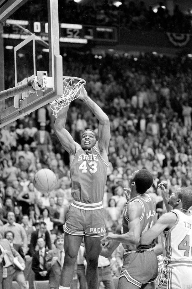 North Carolina State's Lorenzo Charles (43) dunks the ball in the basket to give N.C. State a 54-52 win over Houston in the NCAA Championship game in Albuquerque, N.M., Monday night, April 4, 1983. Photo: Associated Press File Photo / AP1983