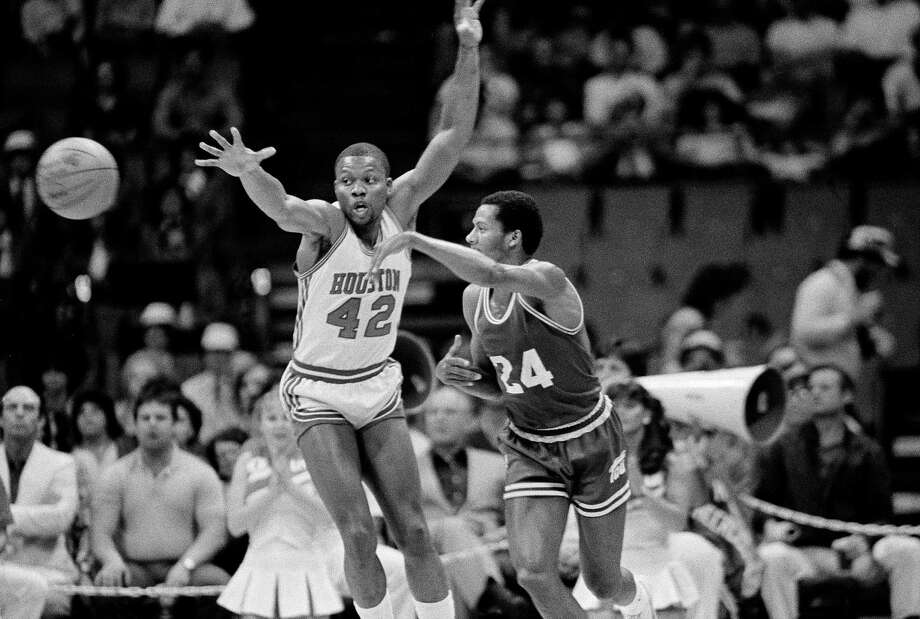 University of Houston's Michael Young (42) tries to make a steal against Texas Christian University forward Darrell Browder (24) during first quarter action in Dallas, March 12, 1983, during the Southwest Conference championship tournament.  Young did not get the steal. Photo: Bill Haber, Associated Press File Photo / AP1983