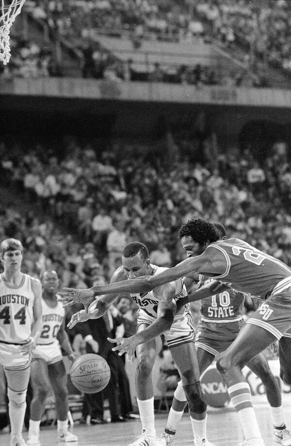 Houston center Larry Micheaux, left, and Memphis State forward Keith Lee (24) scramble for a loose rebound beneath the Memphis State basket in the second half of the game in Kansas City, March 26, 1983.  Houston won the NCAA Midwest Regional semi-final, 70-63. Photo: Bill Haber, Associated Press File Photo / 1983 AP