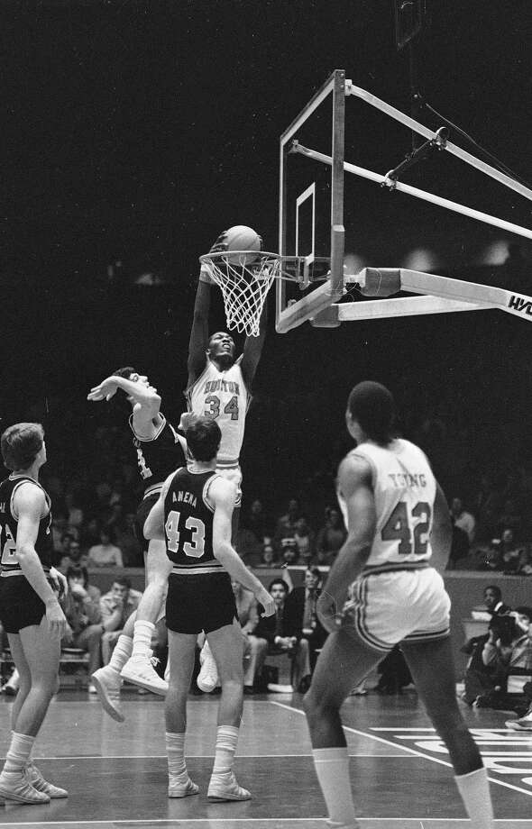 University of Houston's Akeem Abdul Olajuwon soars high to dunk the ball over Rice Owls' Tony Barnett (30) during the first half of the Southwest Conference game at Hofheinz Pavilion, Houston, Feb. 26, 1983. Photo: Associated Press File Photo