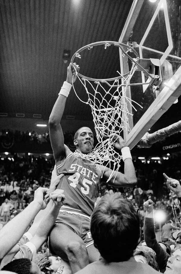North Carolina State center Cozell McQueen goes after the net during the victory celebration after defeating Houston 54-52 Monday night,  April 4, 1983 to win the NCAA crown in Albuquerque. Photo: Anonymous, Associated Press File Photo / AP1983