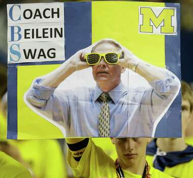 A Michigan fan holds signage showing Michigan head coach John Beilein before the first half of the NCAA Final Four tournament college basketball championship game against the Louisville, Monday, April 8, 2013, in Atlanta. (AP Photo/Charlie Neibergall) Photo: Charlie Neibergall, Associated Press / AP