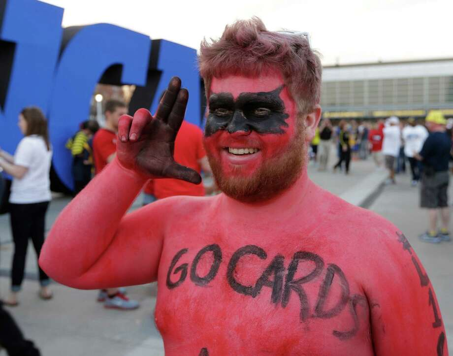 Louisville fan Nick Pappe cheers outside the Georgia Dome before the first half of the NCAA Final Four tournament college basketball championship game against the Michigan, Monday, April 8, 2013, in Atlanta. (AP Photo/John Bazemore) Photo: John Bazemore, Associated Press / AP