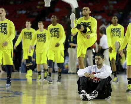 Road to Atlanta: Look back at the full March Madness bracketLive updates: Follow all the Final Four actionLouisville guard Peyton Siva sits on the floor as Michigan players warm up during the first half of the NCAA Final Four tournament college basketball championship game Monday, April 8, 2013, in Atlanta. (AP Photo/Charlie Neibergall) Photo: Charlie Neibergall, Associated Press / AP