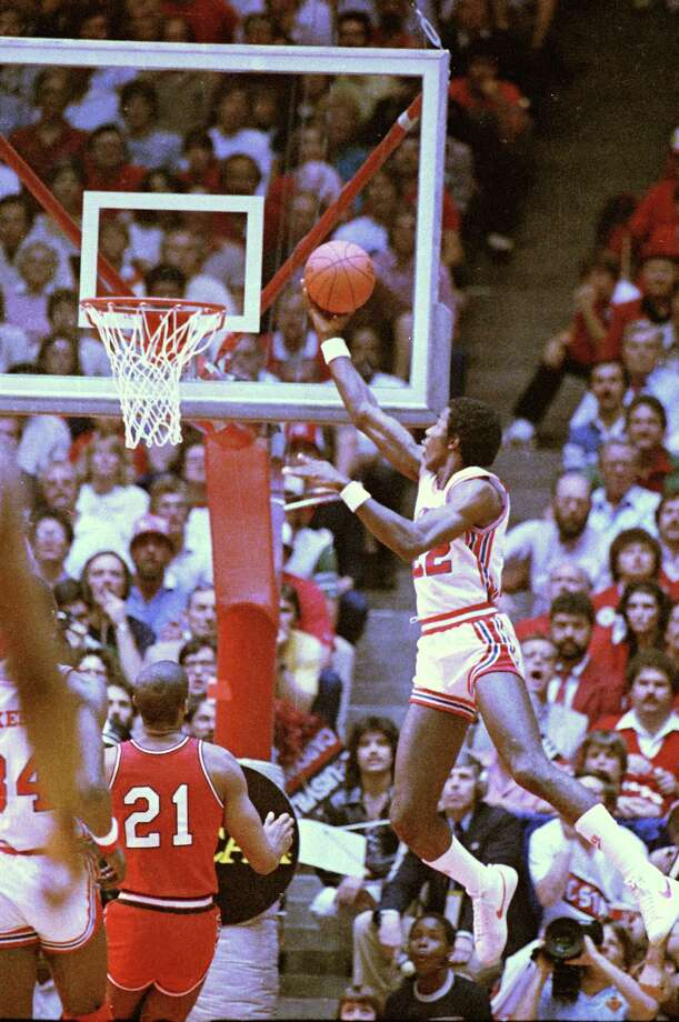 Clyde Drexler, Houston's junior forward, lays up the ball for two points during the Saturday contest in Albuquerque against Louisville, April 2, 1983. Drexler finished the afternoon with 21 points in Houstons 94-81 win over Louisville. Photo: Associated Press File Photo / AP2006