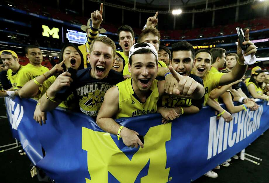 Michigan fans cheer before the first half of the NCAA Final Four tournament college basketball championship game against the Louisville, Monday, April 8, 2013, in Atlanta. (AP Photo/Charlie Neibergall) Photo: Charlie Neibergall, Associated Press / AP