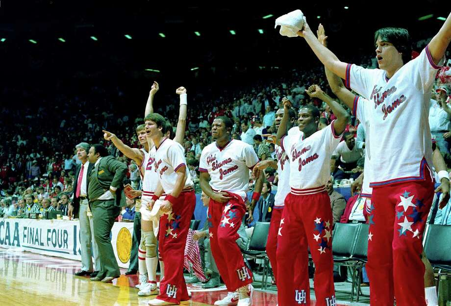 The Houston Cougar bench reacts to a slam dunk during action against the Louisville Cardinals in the NCAA game at the University of New Mexico Arena in Albuquerque, N.M., April 2, 1983. Photo: Associated Press File Photo