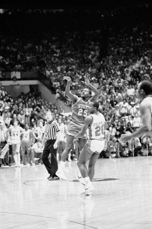 Dereck Whittenburg (25) makes the shot which was to be dunked a spilt second later by Lorenzo Charles of N.C. State to win the game over Houston, April 4, 1983, Albuquerque, N.M. Photo: Anonymous, Associated Press File Photo / AP1983