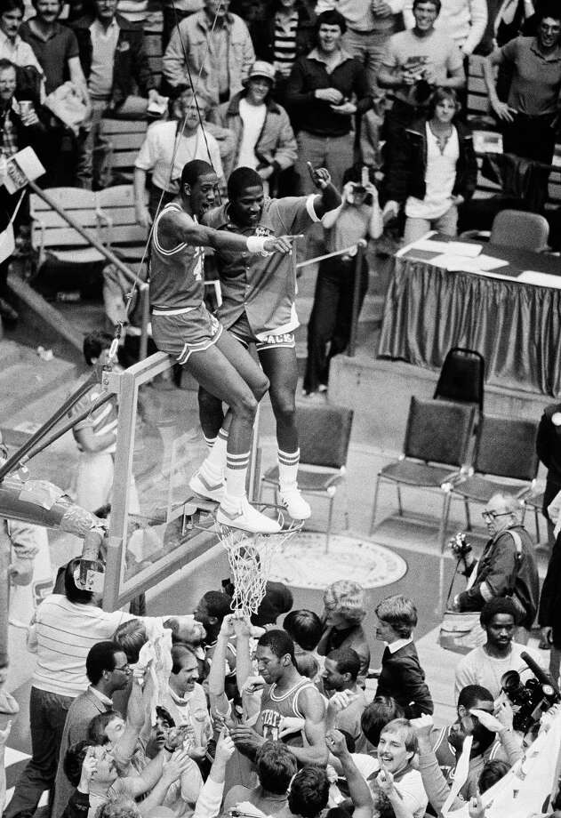 Cozell McQueen, left, and Ernie Myers, both of North Carolina State celebrate their win high on the backboard April 4, 1983 in Albuquerque after defeating Houston 54-52 to win the NCAA basketball crown. Photo: Anonymous, Associated Press File Photo / AP1983