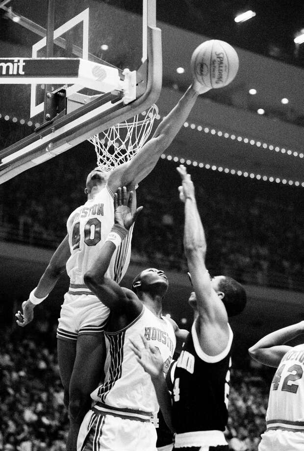 University of Houston's Akeem Abdul Olajuwon guards Maryland's Ben Coleman (54) as Houston's Larry Micheaux (40) goes high to block Coleman's shot during the first half of the second round of NCAA Midwest Regionals at Houston, March 19, 1983. Photo: Associated Press File Photo