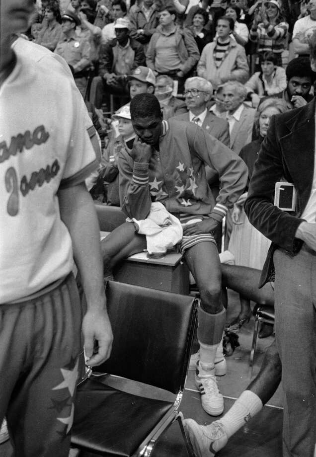 University of Houston's Akeem Abdul Olajuwon sits stunned after the last second shot by Lorenzo Charles of North Carolina State won the game at Albuquerque, N.M., April 4, 1983 in the NCAA final.  Olajuwon scored 20 points in the game. Photo: Associated Press File Photo