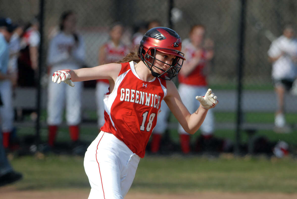Greenwich's Colleen Bennett rounds the bases as Greenwich High School hosts Trinity Catholic in a softball game in Greenwich, Conn., April 8, 2013. Greenwich won the game.