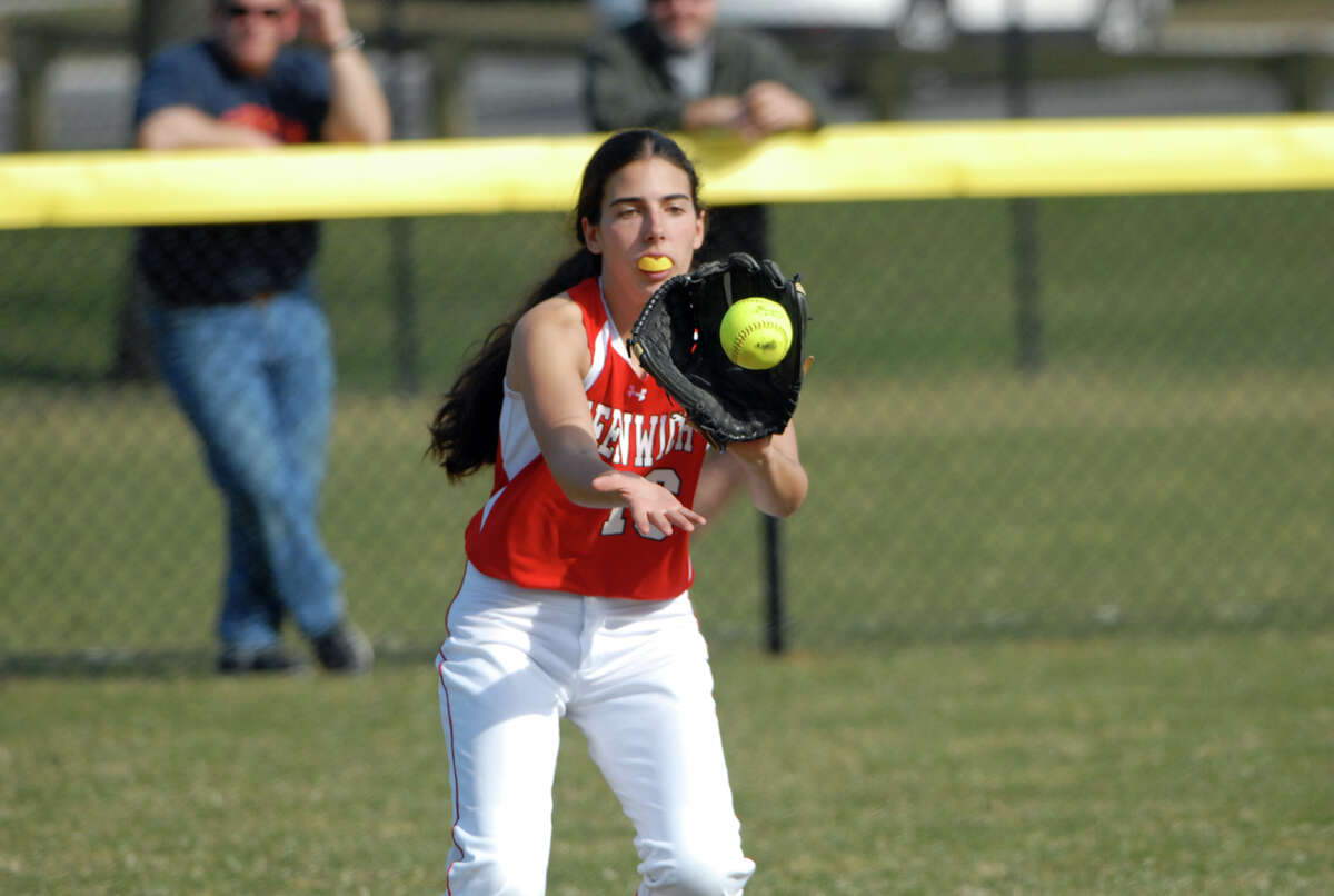 Greenwich's Erin White fields the ball as Greenwich High School hosts Trinity Catholic in a softball game in Greenwich, Conn., April 8, 2013. Greenwich won the game.