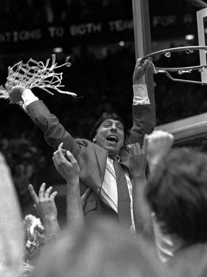 North Carolina State coach Jim Valvano waves the net in victory after defeating Houston in the NCAA Final Four Championship game in Albuquerque, N.M., in this April 4, 1983 file photo. Photo: LEONARD IGNELZI, Associated Press File Photo / AP