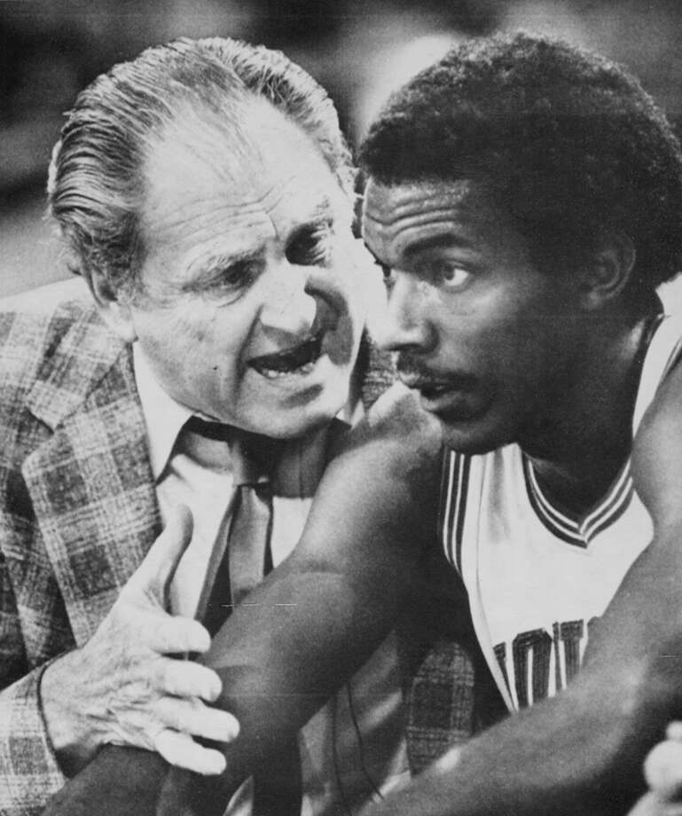Houston head coach Guy Lewis gives instructions to forward Clyde Drexler on the Houston bench in the first half of the NCAA Midwest Regional championship game in Kansas City on March 27, 1983. Houston beat Villanova, 89-71. Photo: Associated Press File Photo / FILE PHOTO