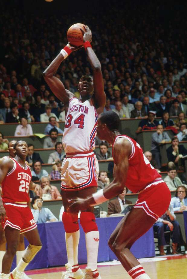 Akeem Olajuwon #34 of the Houston Cougars takes a jumpshot during the NCAA Championship game against the North Carolina State Wolfpack on April 4, 1983 in Albuquerque, N.M.  The Wolfpack defeated the Cougars 54-52. Photo: Focus On Sport, Focus On Sport / Getty Images / 1980 Focus on Sport