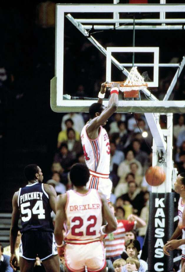 Akeem Olajuwon #34 of the Houston Cougars dunks against the Villanova University Widcats during the 1983 NCAA Midwest Region Elite Eight game on March 27, 1983 in Kansas City, Missouri. The Cougars defeated the Wildcats 89-71. Photo: Collegiate Images, Houston / Collegiate Images / Getty Images / 1981-Houston