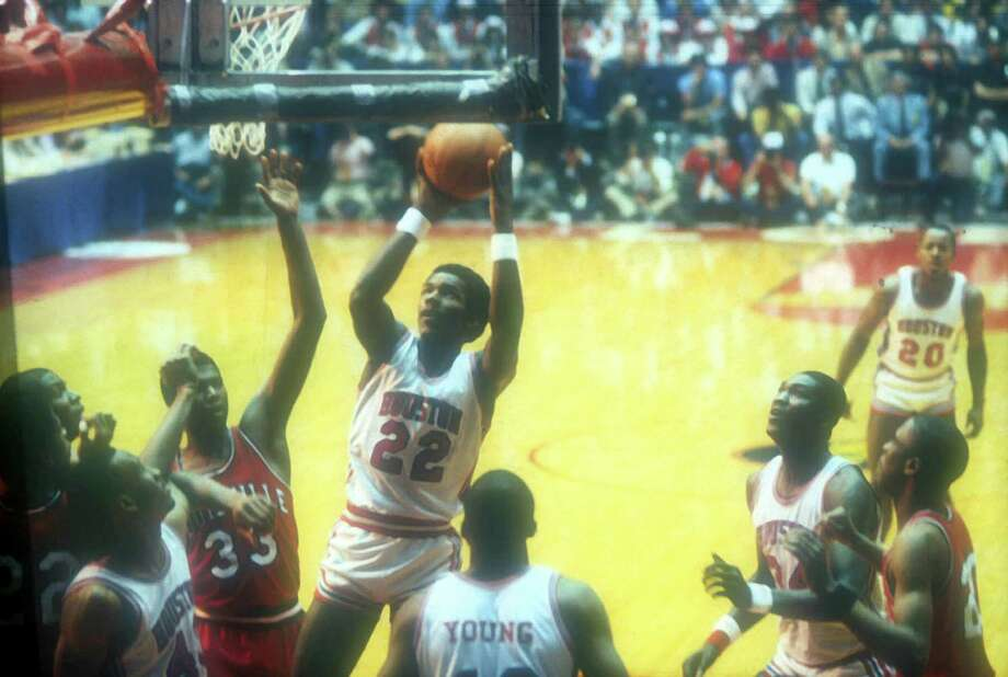 Clyde Drexler #22 of the University of Houston Cougars leaps up against the University of Louisville Cardinals during he NCAA Final Four in Albuquerque, New Mexico, on April 2, 1983. The Cougars defeated the Cardinals 94-81. Photo: Collegiate Images, LLC, Collegiate Images, LLC / WireImage / 1983 Houston