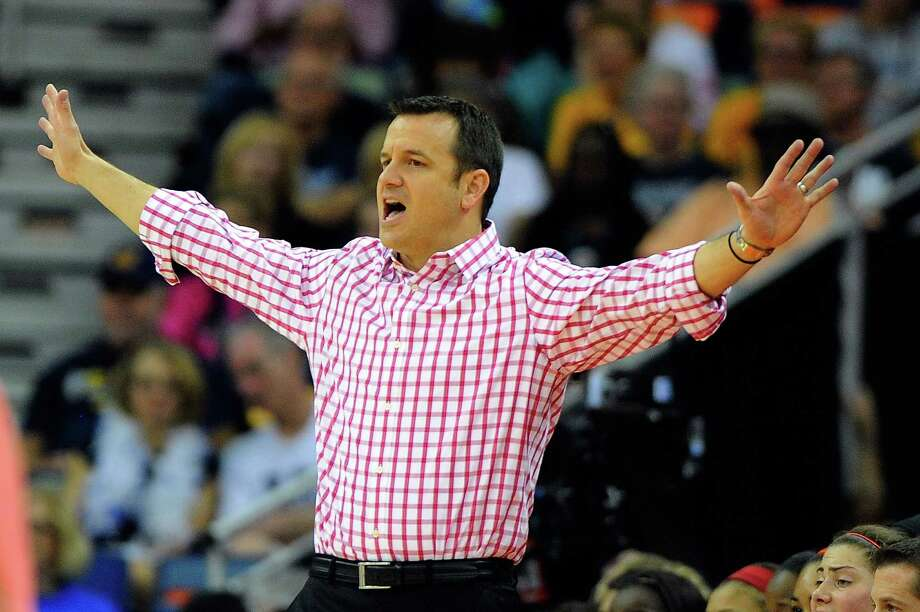 NEW ORLEANS, LA - APRIL 07: Jeff Walz, head coach of the Louisville Cardinals instructs his team against the California Golden Bears during the National Semifinal game of the 2013 NCAA Division I Women's Basketball Championship at New Orleans Arena on April 7, 2013 in New Orleans, Louisiana. (Photo by Stacy Revere/Getty Images) Photo: Stacy Revere, Getty Images / 2013 Getty Images