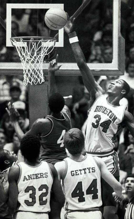 Houston's #34 Akeem Olajuwon blocks a shot attempt by Louisville's #4 Lancaster Gordon in Albuquerque, N.M. on April 2, 1983. Cougars Benny Anders and Reid Gettys look on. Photo: Timothy Bullard, Houston Chronicle File Photo / Houston Chronicle
