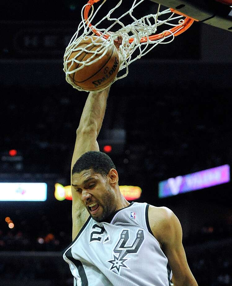 Tim Duncan of the Spurs dunks over the Cleveland Cavaliers during second-half action at the AT&T Center on Saturday, March 16, 2013. Photo: Billy Calzada, San Antonio Express-News / San Antonio Express-News