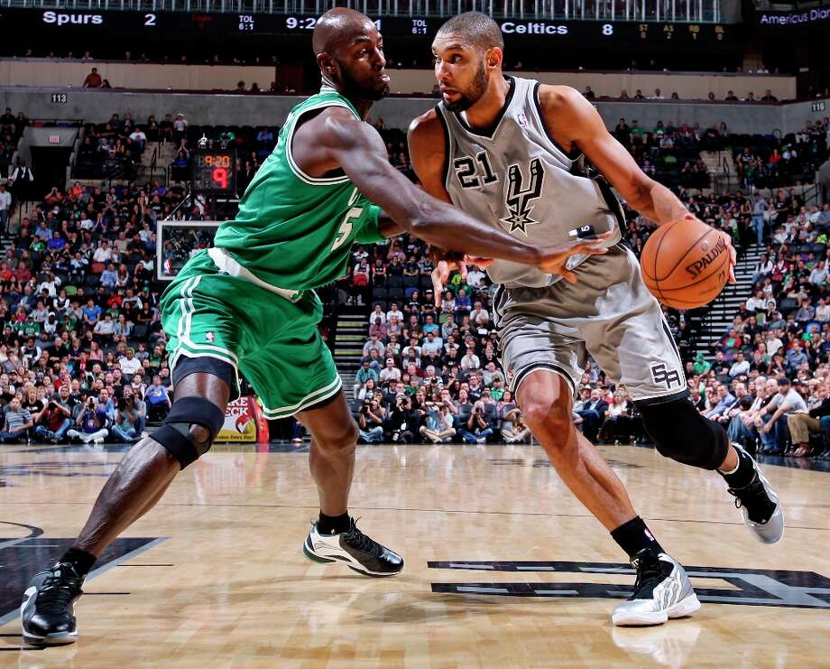 The Spurs' Tim Duncan looks for room around Boston Celtics' Kevin Garnett during first half action Saturday Dec. 15, 2012 at the AT&T Center. Photo: Edward A. Ornelas, San Antonio Express-News / © 2012 San Antonio Express-News