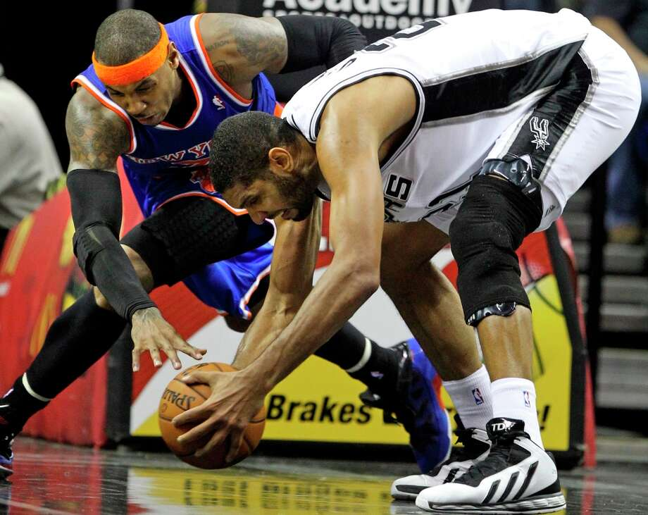 Tim Duncan grabs a loose ball as Carmelo Anthony circle around then fouls as San Antonio hosts the New York Knicks at the AT&T Center on Nov. 15, 2012. Photo: Tom Reel, San Antonio Express-News / ©2012 San Antono Express-News