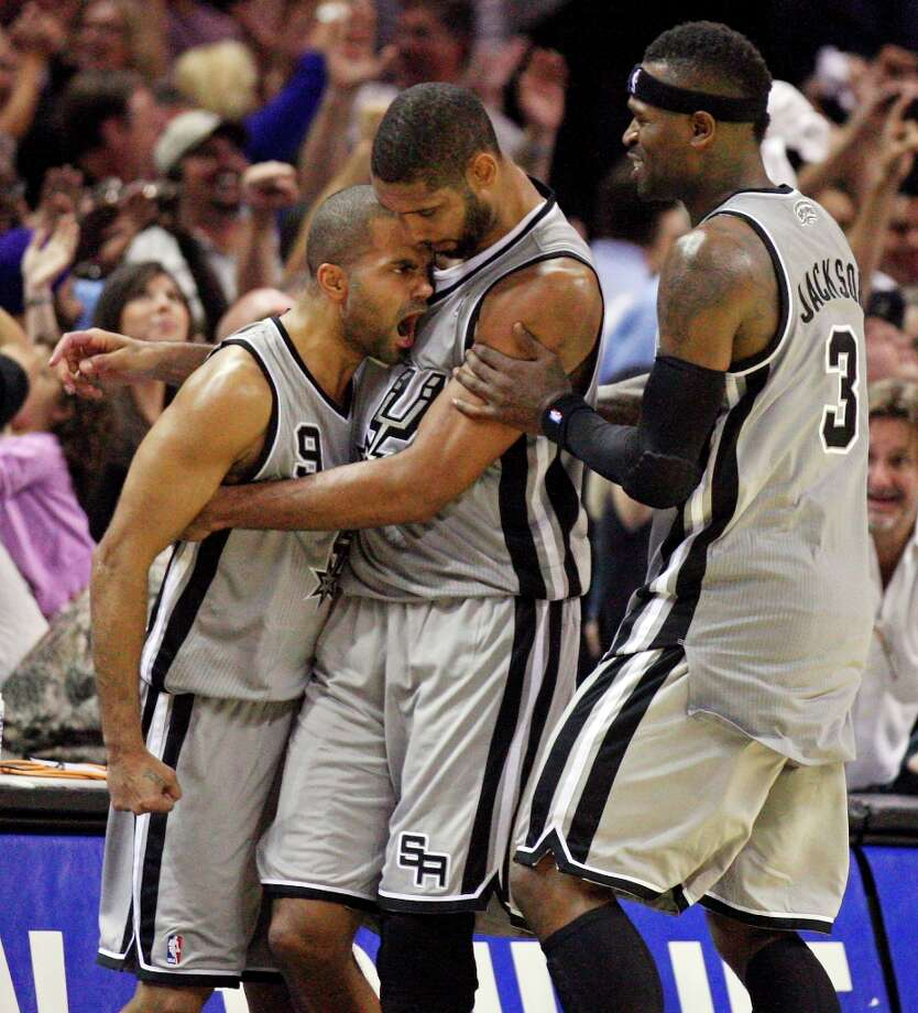 San Antonio Spurs' Tony Parker (from left) is congratulated by teammates Tim Duncan and Stephen Jackson after making a two point basket to win the game against the Oklahoma City Thunder during second half action Thursday, Nov. 1, 2012 at the AT&T Center. The Spurs won 86-84. Photo: Edward A. Ornelas, San Antonio Express-News / © 2012 San Antonio Express-News